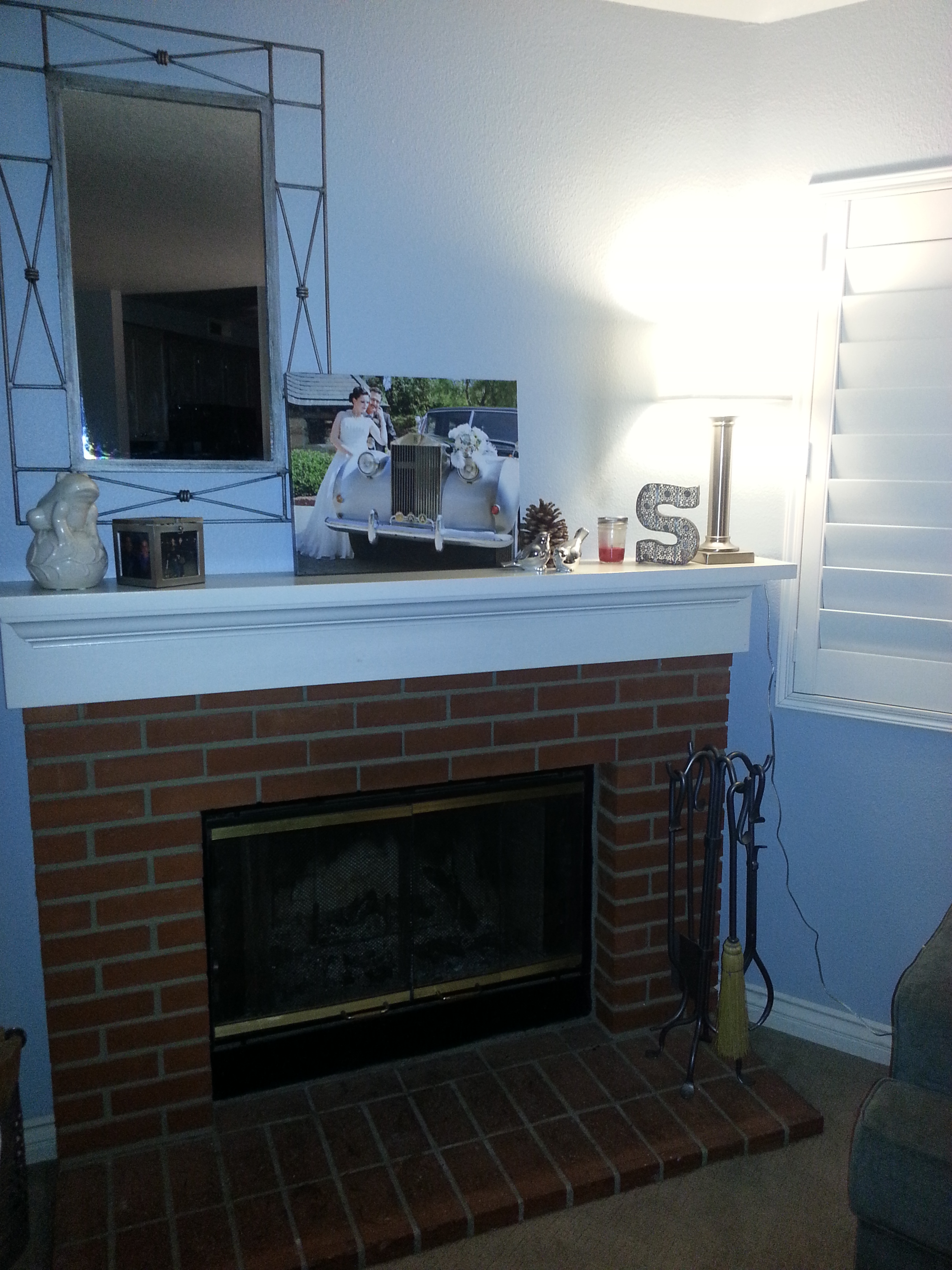 So it is really hard to get a good photo of a fireplace with a mirror on it and not be in the photo, so here is an okay after shot.